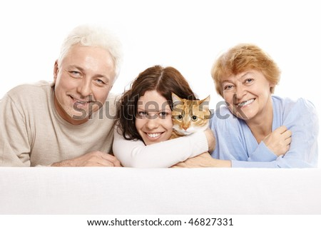 Happy family with a cat on a white background - stock photo