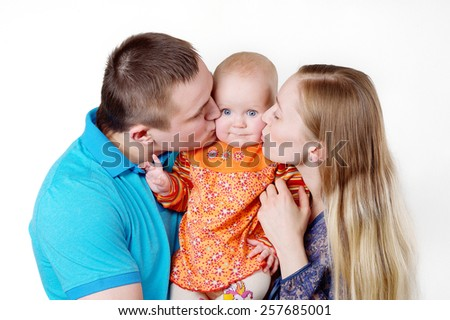 Happy family with a 6 month old baby photo session in studio on a white background - stock photo