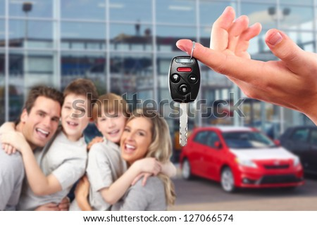 Happy family with a new car. Driving and transportation concept.