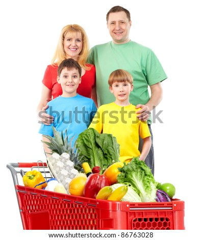Happy family with a shopping cart. Isolated over white background. - stock photo