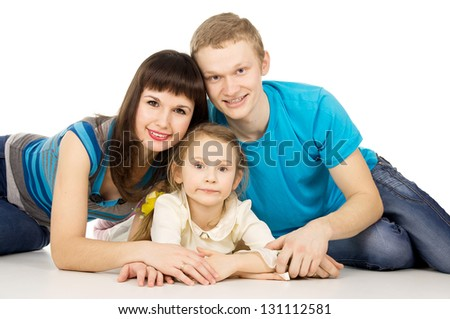 happy family with a small child girl