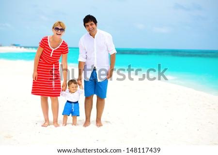Happy family with baby having tropical vacation  - stock photo
