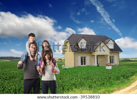 happy family with beautiful house in the countryside on the background - stock photo