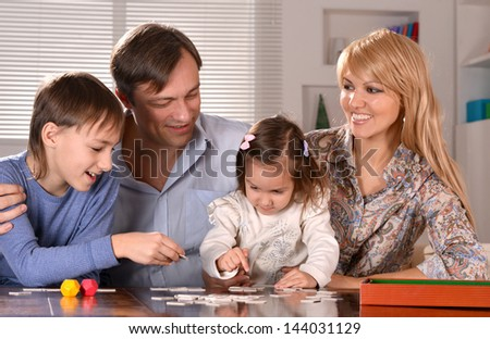 happy family with cheerful children spending time at home - stock photo