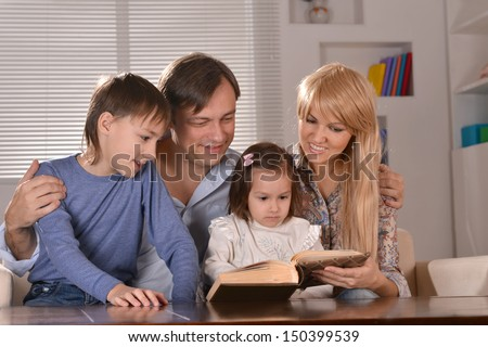 happy family with cheerful children spending time at home