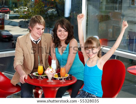 Happy family with child in cafe. Parenting.
