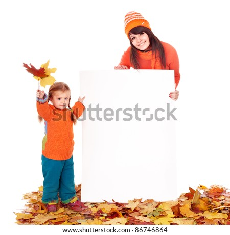Happy family with child on autumn leaves holding banner. - stock photo