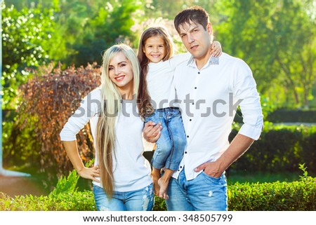 Happy family with child outdoors. in jeans