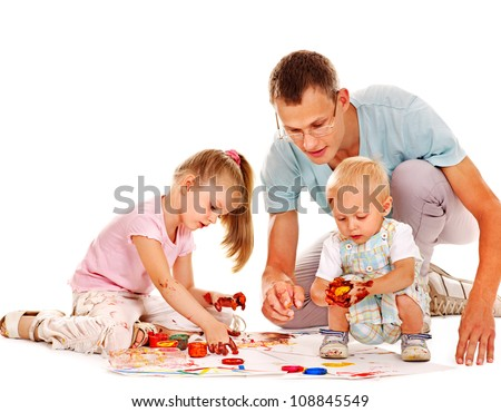 Happy family with child painting by finger paint.