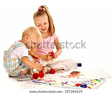 Happy family with child painting by finger paint. - stock photo