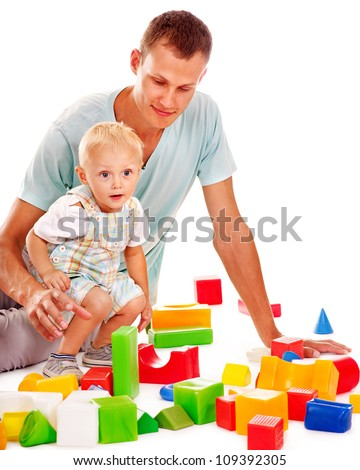 Happy family with child playing building blocks. Isolated.