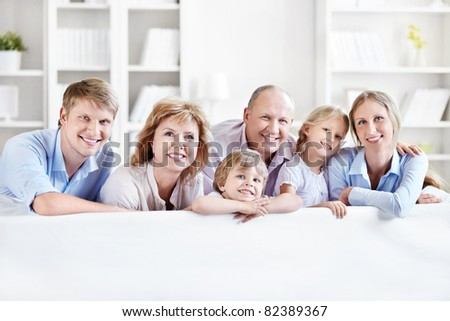 Happy family with children and grandchildren on the couch - stock photo