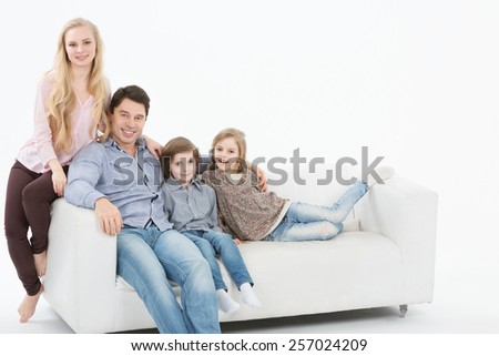 Happy family with children at home white background