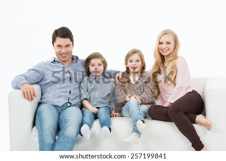 Happy family with children at home white background - stock photo
