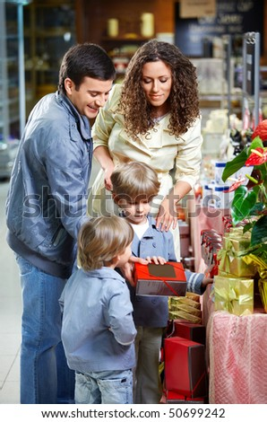 Happy family with children choose gifts - stock photo