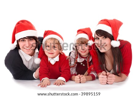 Happy family with children in santa hat.  Isolated. - stock photo