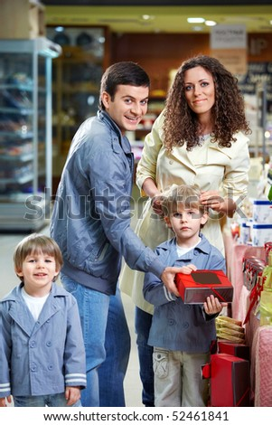 Happy family with children in shop - stock photo