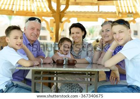 Happy family with coffee - stock photo