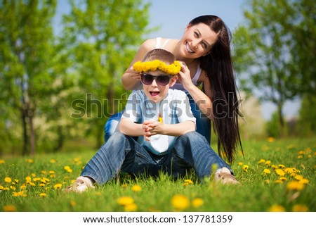happy family with dandelions in a green park