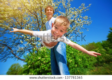 happy family with dandelions in a green park - stock photo
