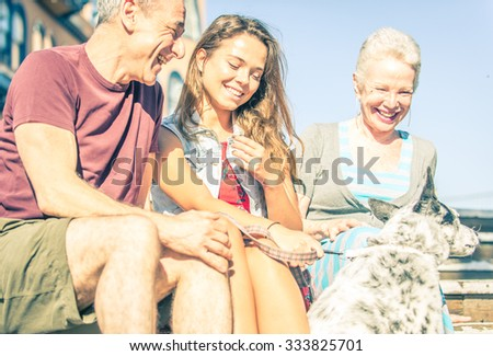 Happy family with dog in Santa monica, Los angeles. concept about people, family and happiness - stock photo