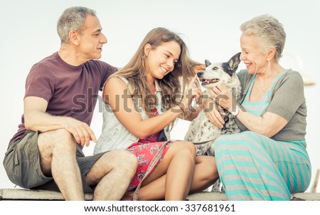 Happy family with dog in Santa monica, Los angeles. concept about people, family and happiness. Straight focus on the young daughter - stock photo
