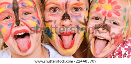Happy family with face painting - stock photo