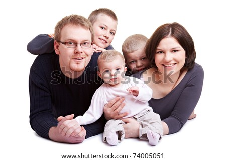 Happy family with father and mother and three children including baby - stock photo