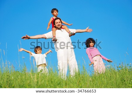 Happy family with four members on beautiful scene in nature - stock photo