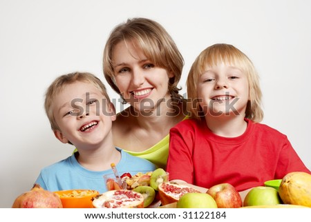 Happy family with fruit - stock photo