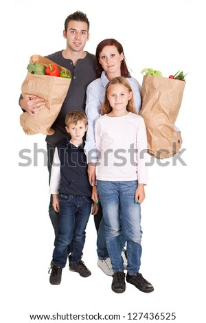 Happy family with grocery shopping bags. Isolated on white - stock photo