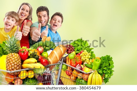 Happy family with grocery shopping cart. - stock photo