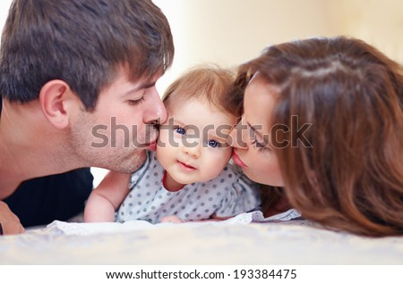 happy family with infant baby girl at home - stock photo