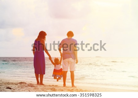 happy family with kid having fun on sunset tropical beach