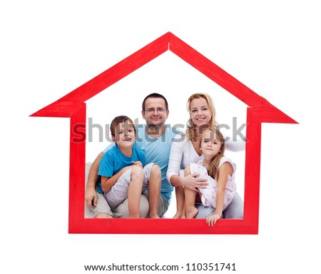Happy family with kids in their home concept sitting in a house shaped frame - isolated
