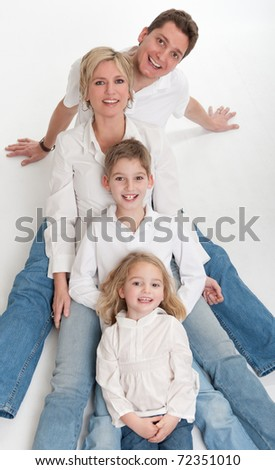 Happy family with kids leaning on each other - stock photo