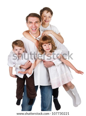 happy family with kids on white bed in the bedroom