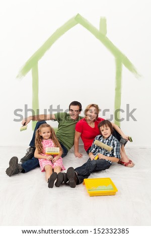 Happy family with kids redecorating their home together concept