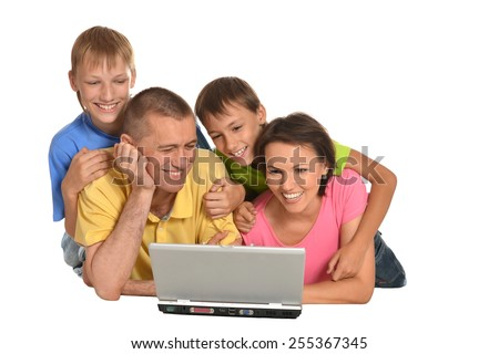 Happy family with laptop on white background - stock photo