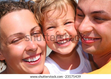 Happy family with little girl, faces