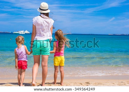 Happy family with little kids having fun at exotic beach on sunny day - stock photo