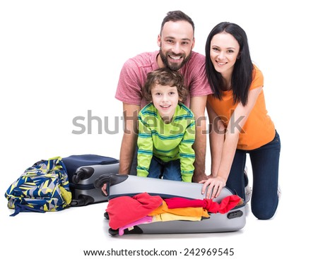 Happy family with luggage are ready to travel. Isolated on white background. - stock photo