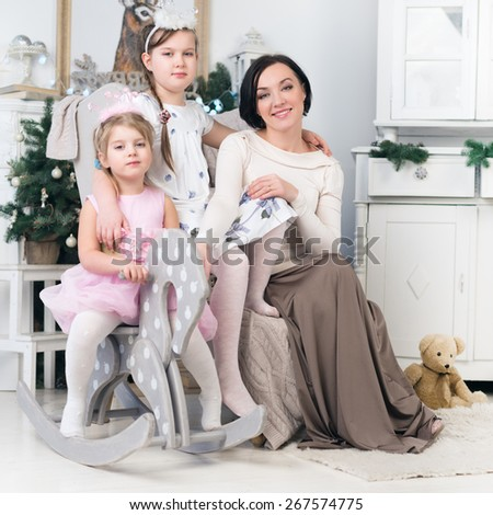 Happy family with mother and young daughters - stock photo