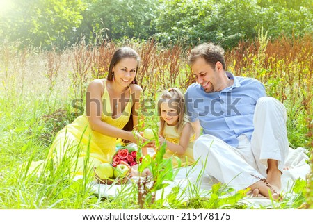 happy family with my daughter on a picnic - stock photo