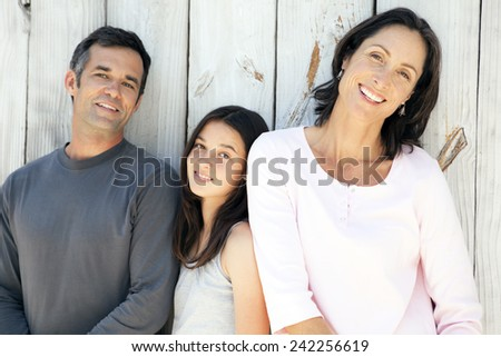 Happy family with one child - stock photo