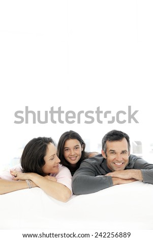 Happy family with one child lying down in front of the camera