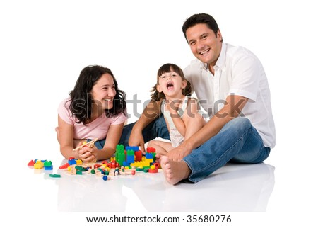 Happy family with parents and daughter playing with colorful blocks isolated on white background - stock photo