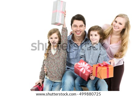 Happy family with presents. Father and mother give presents to they daughter looking at camera isolated. Holiday concept.