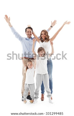 Happy family with raised hands up isolated on white background - stock photo