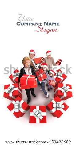 Happy family with Santa�¢??s hats surrounded by gifts